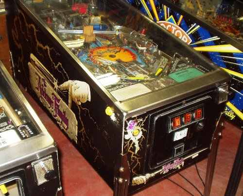 Addams Family pinball machine with gold cabinet